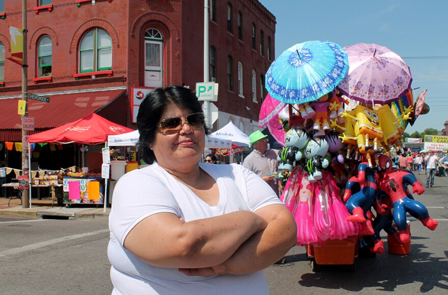 Minerva Lopez, owner of Gooolll! and organizer of Cherokee Street Business Owners Association during the Cinco de Mayo Festival on Saturday, May 2, 2015.