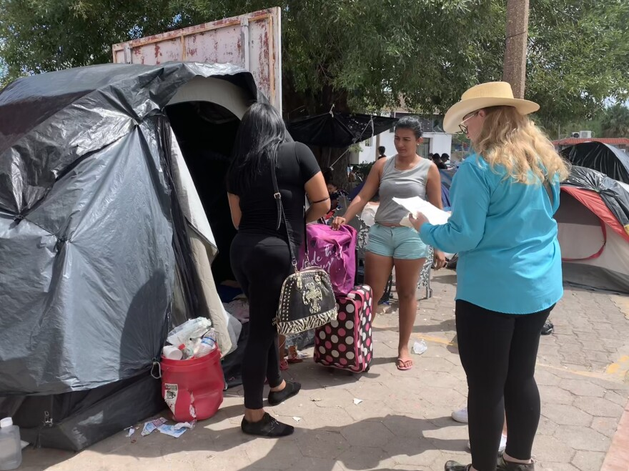 Mayela gathers her belongings from a tent before going into the U.S.