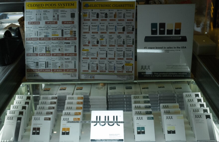 A vaping kiosk in a mall in the Philippines sells Juul e-cigarette pods, including fruit and other nontobacco flavors that the company has pulled from U.S. stores.