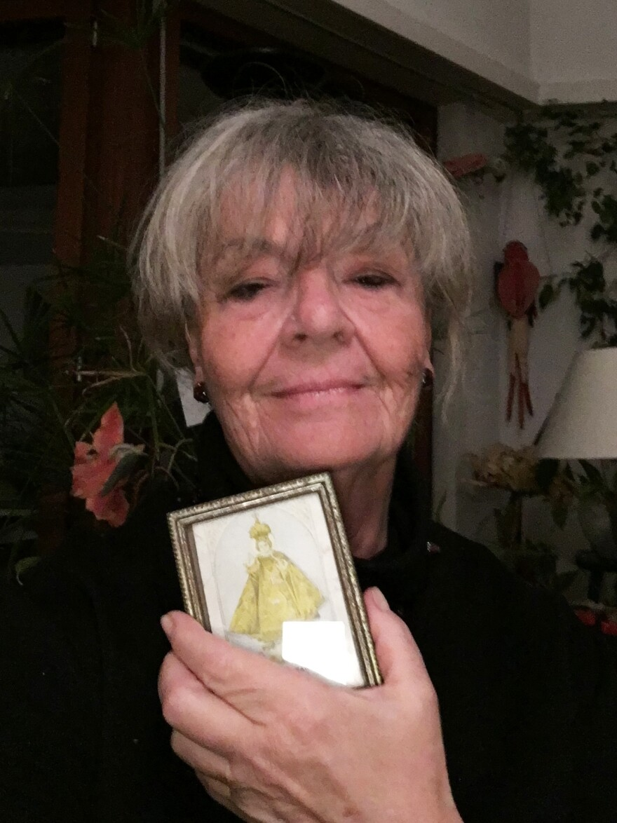 Helen Lom holds an image of the baby Jesus that she took with her when she fled communist Czechoslovakia with her family.