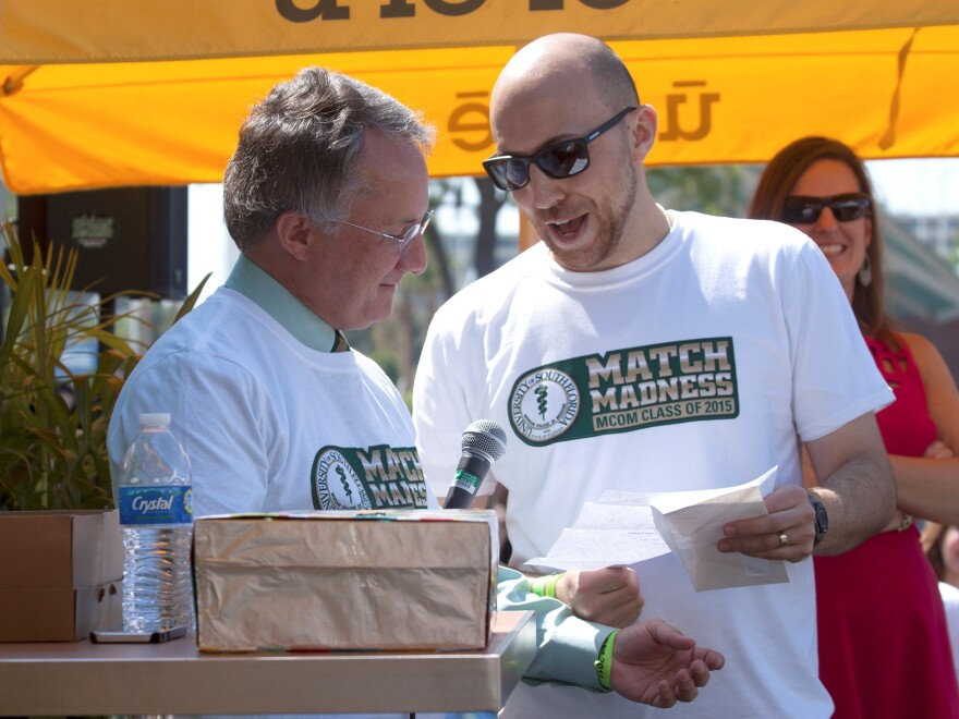 USF medical student Chris DeClue announces his residency at USF in diagnostic radiology on National Match Day, Friday, March 20. Senior Vice President of USF Health, Charles Lockwood, held the mic.