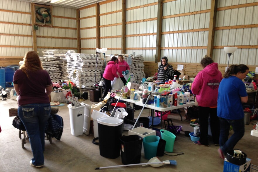 Families peruse the belongings left behind by DePauw students.