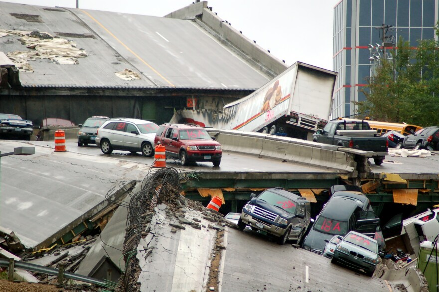 Interstate 35W bridge collapse Minneapolis Minnesota Cars rest on the collapsed portion of I-35W Mississippi River bridge, after the August 1st, 2007 collapse. This was featured as one of the 12 most powerful photos of 2007 on ABC News online. Taken Aug.