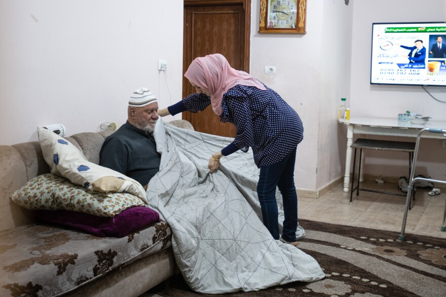 Ramemi attends to her father. She moved in with her parents because her husband is working abroad.