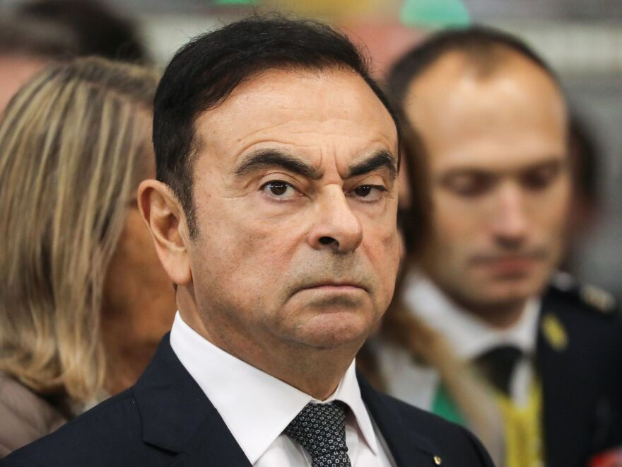 Then Chairman and CEO of Renault-Nissan-Mitsubishi Carlos Ghosn looks on during a visit of French President Emmanuel Macron at the Renault factory weeks before his November arrest.