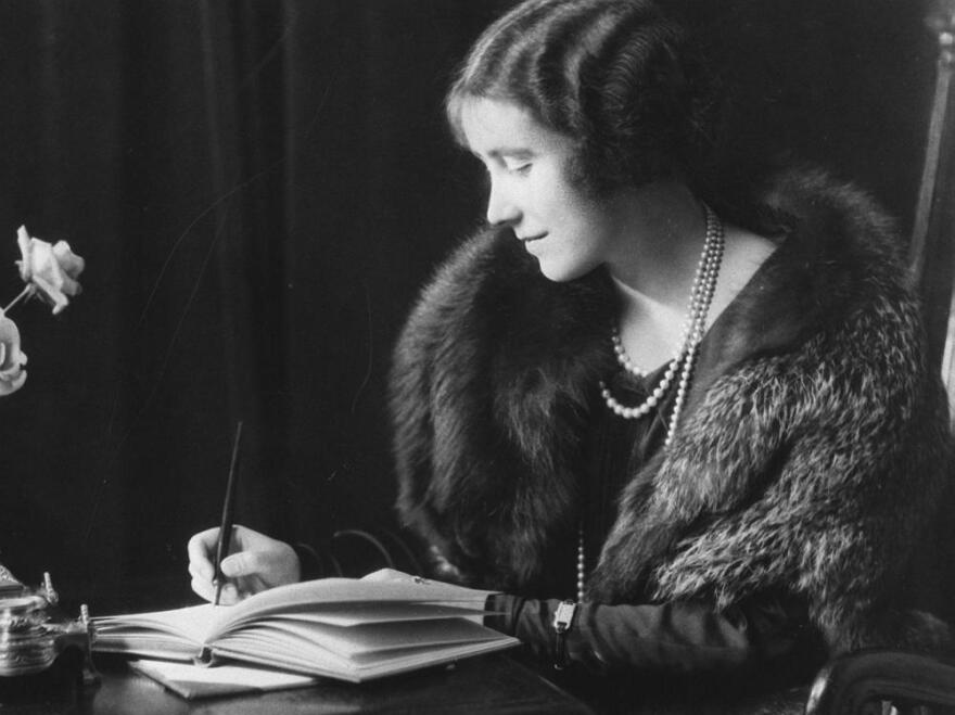 Lady Elizabeth Bowes-Lyon, later Queen Elizabeth the Queen Mother, writing in the year before her 1923 marriage to the Duke of York, later King George VI. Considered the beauty of her generation, some wonder if she actually had hoped to marry his older brother.