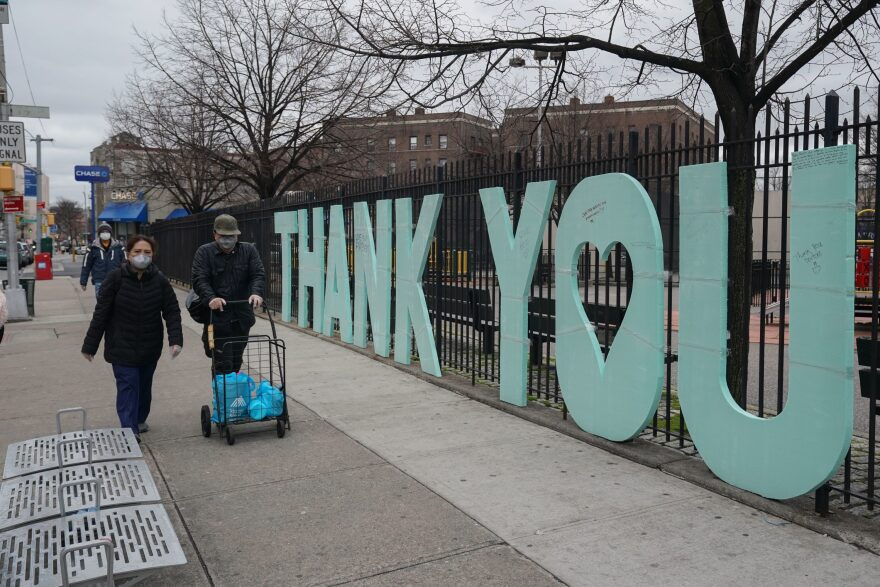 """A """"Thank You"""" sign for first responders stands as a fence across the street from Elmhurst Hospital in the Borough of Queens on March 31, 2020 in New York. (Bryan R. Smith/AFP via Getty Images)"""