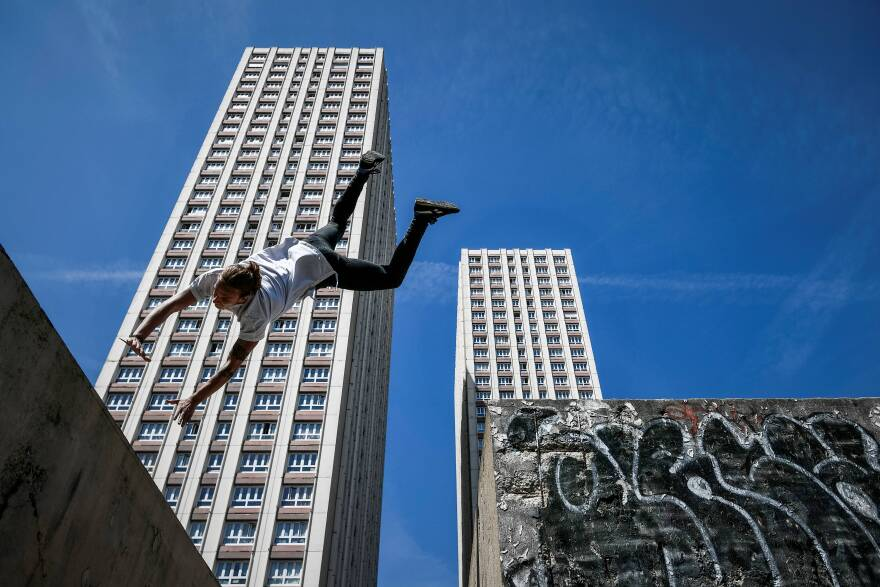 Many in the parkour community are resisting attempts by the International Gymnastics Federation to bring the sport under its umbrella. Here, Johan Tonnoir practices parkour in Paris in May.