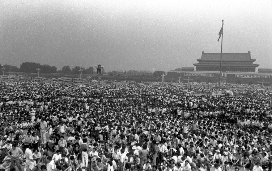 A crowd gathers to view the unveiling of the Goddess of Democracy statue, built by the protesters, on Tiananmen Square at the end of May 1989. The statue was destroyed less than a week later as the violent crackdowns began.