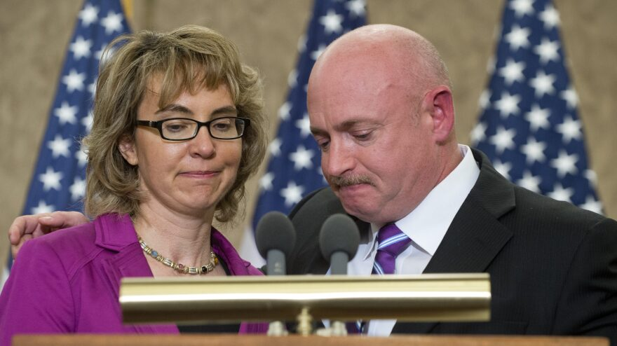 Former Arizona Rep. Gabrielle Giffords and her husband, Mark Kelly, at an April 16 ceremony naming a Capitol Hill conference room for her aide Gabe Zimmerman. Zimmerman died in the same Tucson, Ariz., shootings that Giffords wounded.