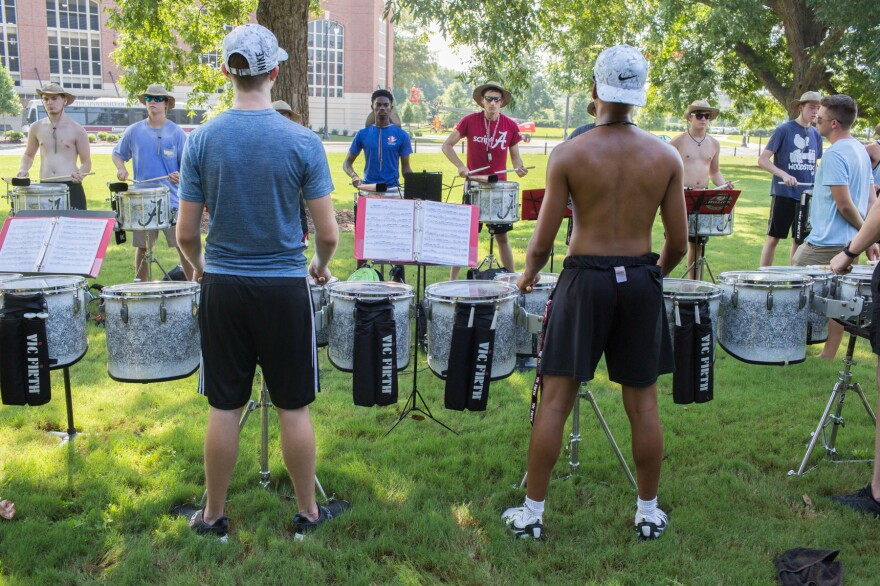 Members of Alabama's Million Dollar Band practice three times a day gearing up for football season. Like the team, the drummers keep playing until they're nearly perfect.
