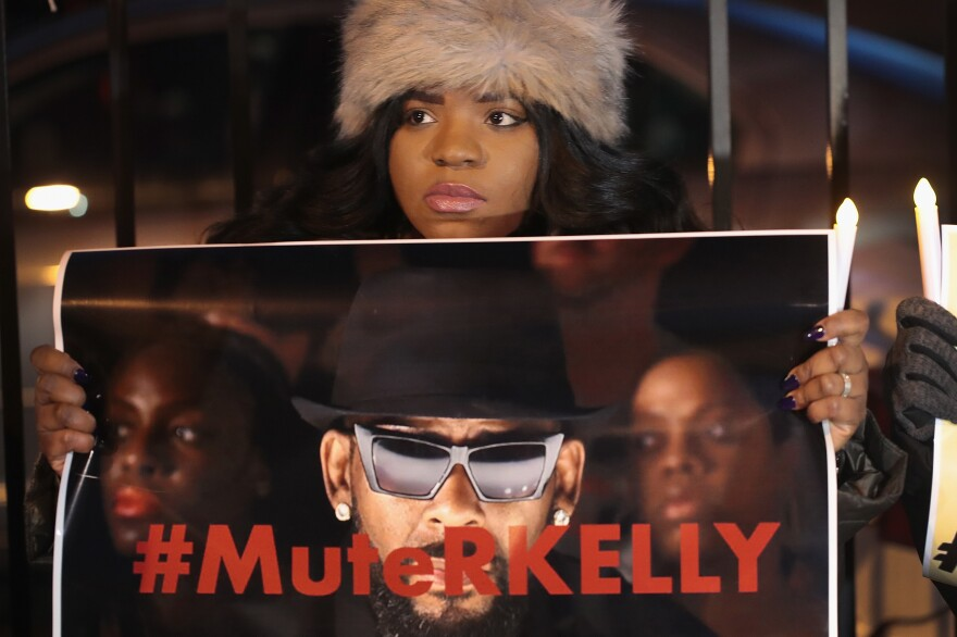 Demonstrators near R. Kelly's studio call for a boycott of his music on Jan. 9, 2019.