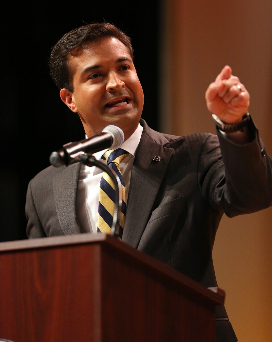 """Republican U.S. Rep. Carlos Curbelo says Congress """"needs to find some answers"""" on gun safety after the Las Vegas mass shooting. He is pictured at a 2016 campaign debate."""
