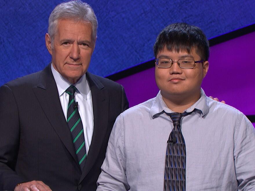 Game show contestant Arthur Chu with host Alex Trebek on the set of <em>Jeopardy!</em>