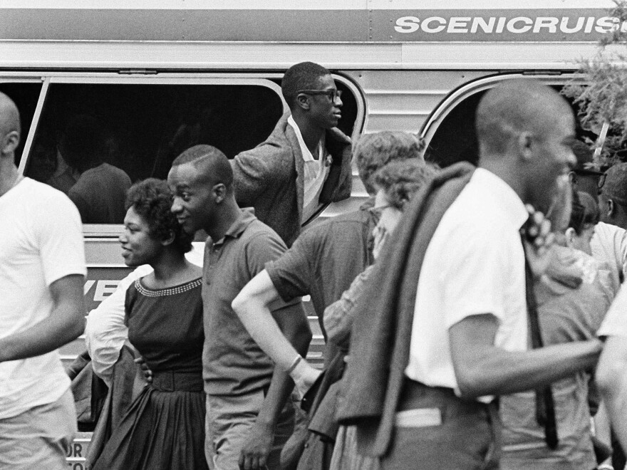 An unidentified Freedom Rider sticks his head out of a chartered bus window in Jackson, Miss., in August 1961.