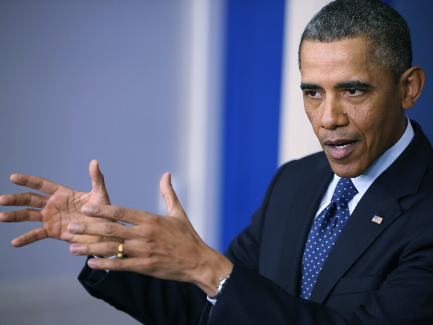 President Obama speaks to the media after the automatic budget cuts associated with the sequester took effect in March 2013.