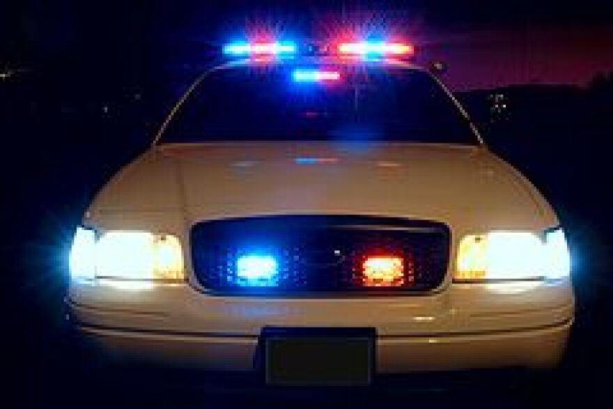 240px-Police_car_with_emergency_lights_on.jpg