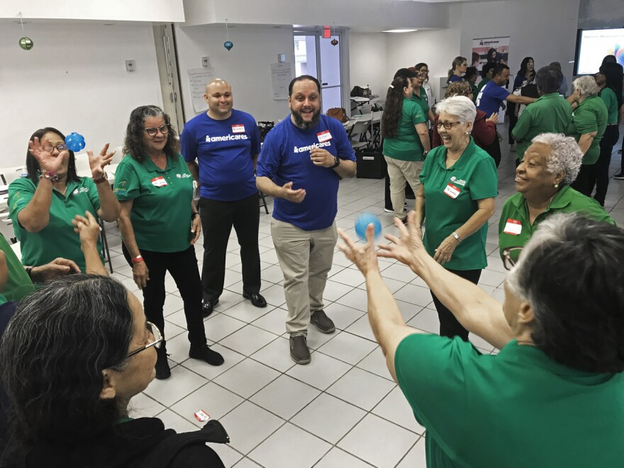 Volunteers at a retirement center in Rio Piedras take part in training to help them recognize and cope with stress and depression that's still a problem two years after Hurricane Maria.