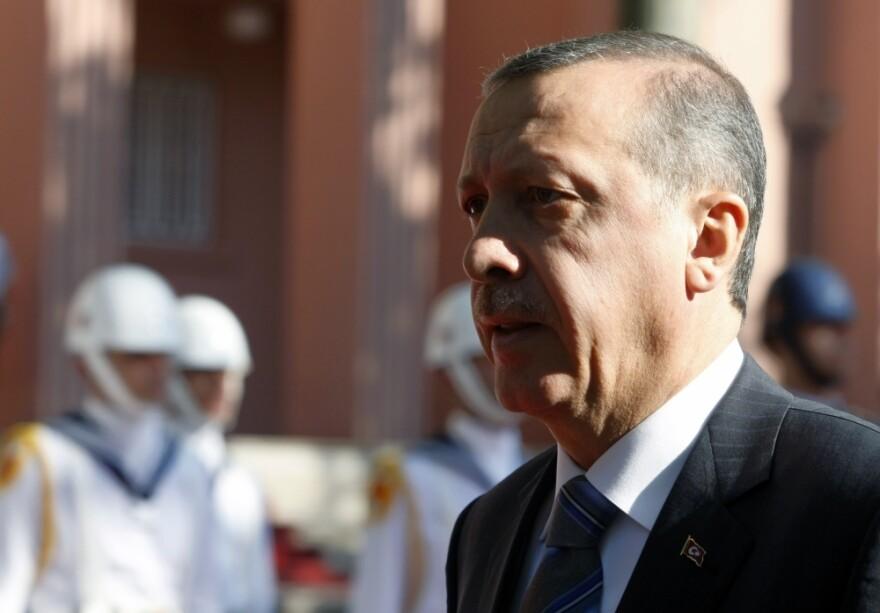 Turkish  Prime Minister Recep Tayyip Erdogan walks before a ceremony outside his office in Ankara, Turkey, Thursday, Sept. 8, 2011.