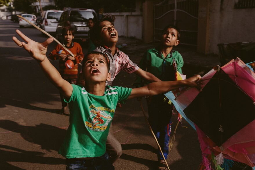 Youngsters get a thrill from the kite-filled sky.