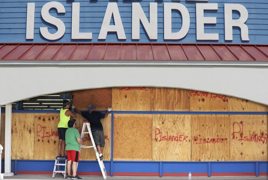 Workers cover a business with plywood in preparation for Hurricane Harvey, Thursday, Aug. 24, 2017, in Corpus Christi, Texas. (Eric Gay/AP)
