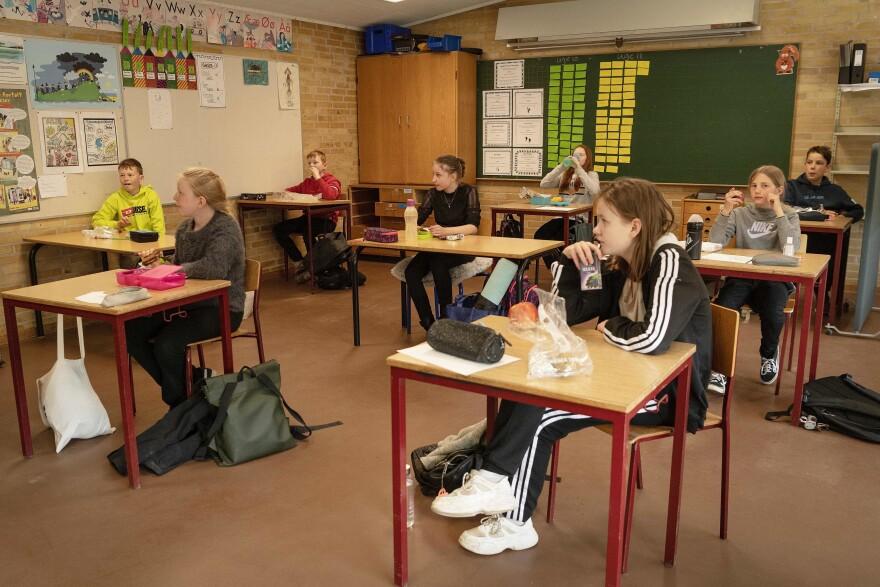 Schoolchildren have lunch at the Korshoejskolen Public school in Randers, Denmark. Denmark began reopening schools on April 15.
