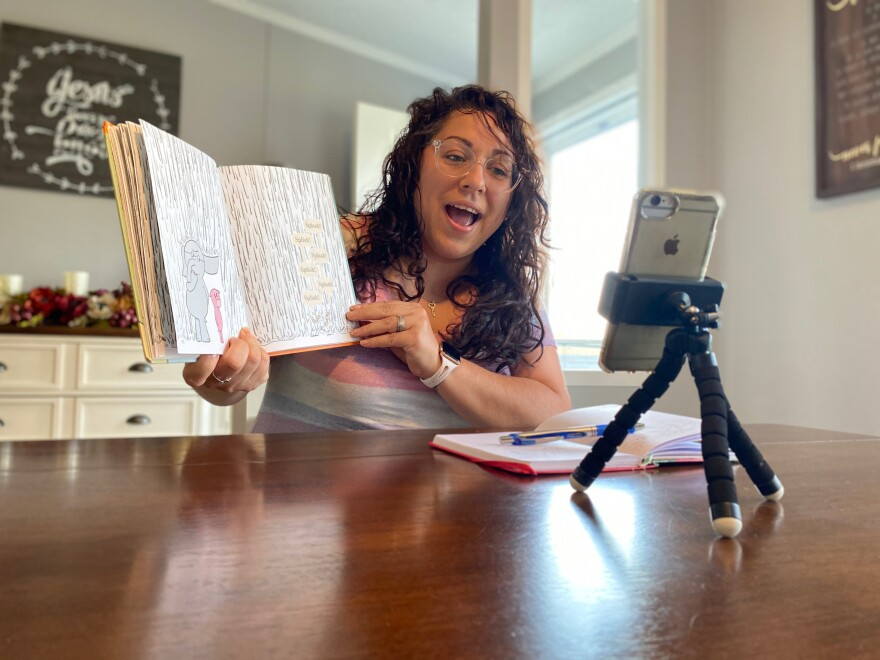 CASA volunteer Norma Davila reads a children's book over FaceTime to the child she advocated for.