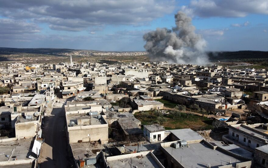 This picture taken on on March 2, 2020 shows smoke plumes rising following aerial bombardment on the village of Balyun in the southern part of Syria's northwestern province of Idlib.