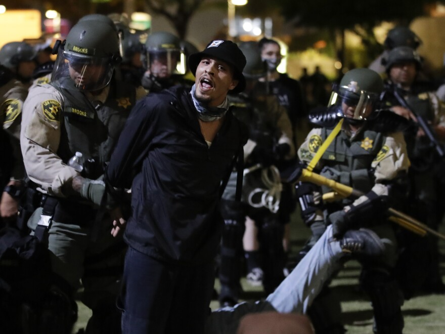 Demonstrators are arrested for a curfew violation Wednesday, June 3 in downtown Los Angeles during a protest over the death of George Floyd.