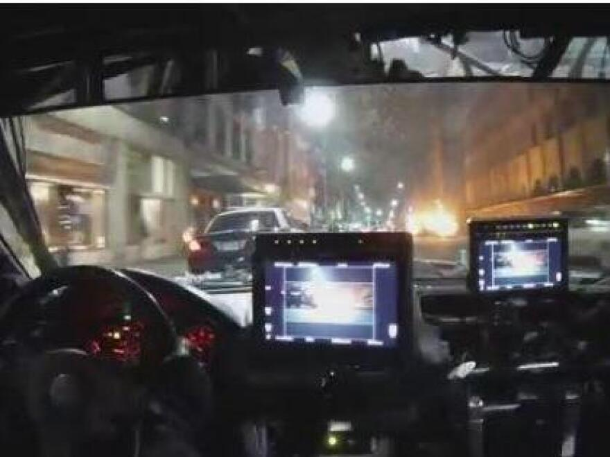 A camera car follows one of <em>Furious 7</em>'s police chases through downtown Atlanta. The picture was snapped moments before the police car ahead on the left hits a parked car (which, of course, flips up in the air and explodes).