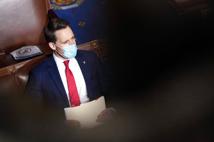 Senator Josh Hawley wears a mask on the floor of the U.S. Senate.