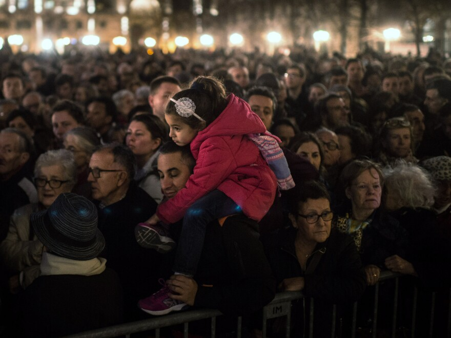 People gather outside of Notre Dame Cathedral in Paris, ahead of a ceremony for the victims of Friday's terrorist attacks. Even as we mourn for those lost in the violence, NPR's Michel Martin says, we should not forget the many who have died in similar attacks the world over.