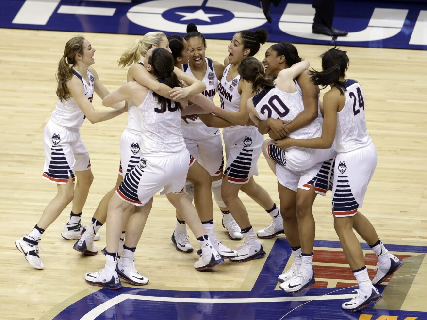 UConn celebrates after defeating Syracuse in the women's Division I NCAA championship game in Indianapolis.