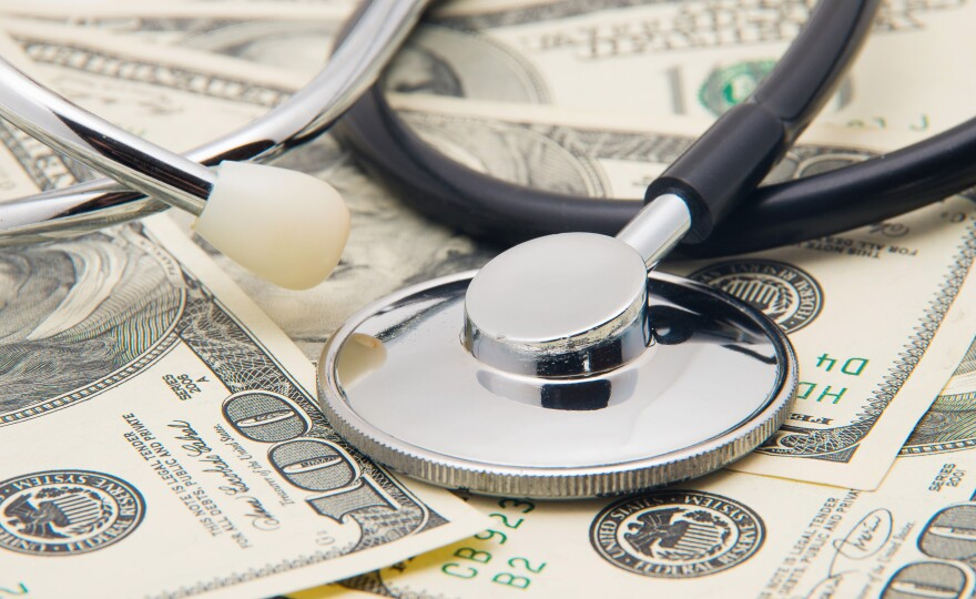 A photo of a stethoscope and money.