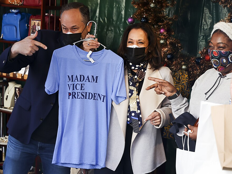 Doug Emhoff, here with his wife, Vice President-elect Kamala Harris, last month at the Downtown Holiday Market in Washington, D.C., will teach a course in the spring semester on entertainment law disputes at Georgetown Law.