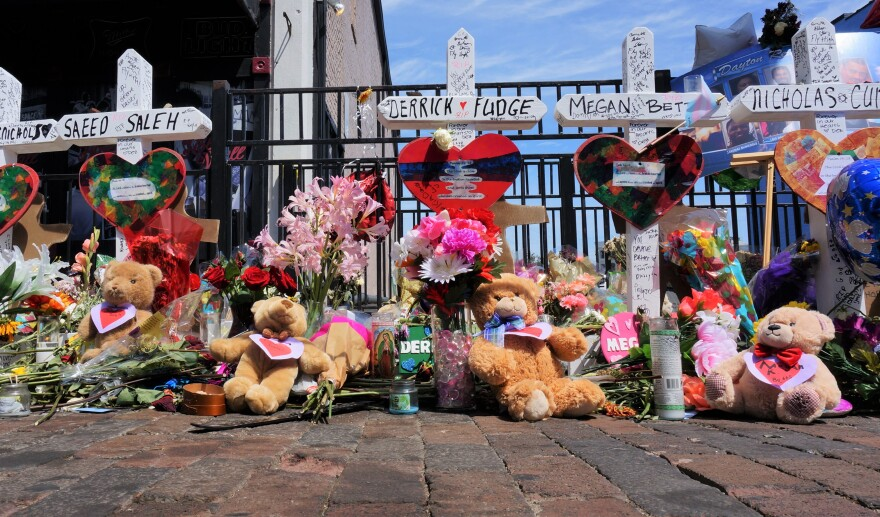The Bridges family drove over an hour to place nine teddy bears on the memorial in the Oregon District, one for each of the victims who lost their lives.
