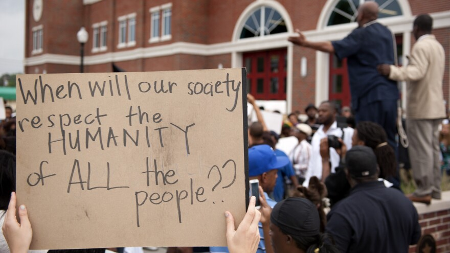 A crowd rallies to protest the shooting of Michael Brown in Ferguson, Mo.