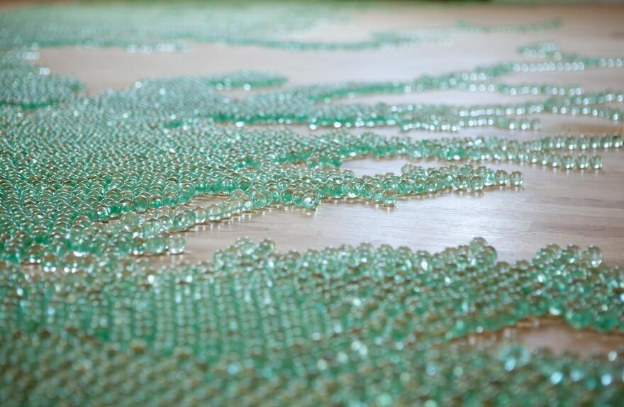 Artist Maya Lin made a map of the Chesapeake Bay using blue-green marbles.