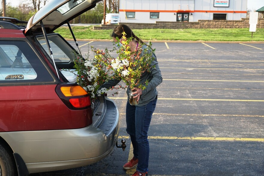 Erin Bernsen, a co-owner of Legacy Circle Farms, gets ready to place an online order in the car of a customer. Before the coronavirus pandemic, the farm did not have a large online presence.
