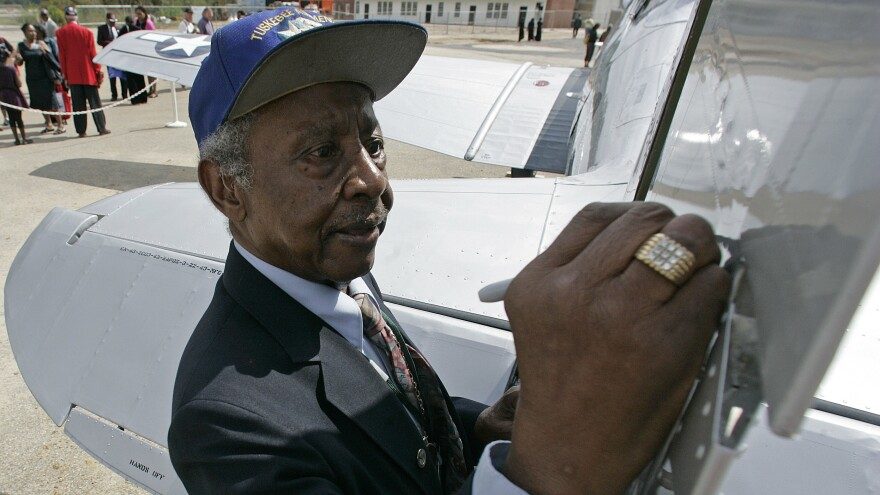 U.S. Air Force Retired Lt. Col. Floyd J. Carter has died at age 95. One of the last of the Tuskegee Airmen, Carter is seen here signing the tail of a TU-43 plane at the opening of the Tuskegee Airmen National Historic Site in Tuskegee, Ala., in 2008.