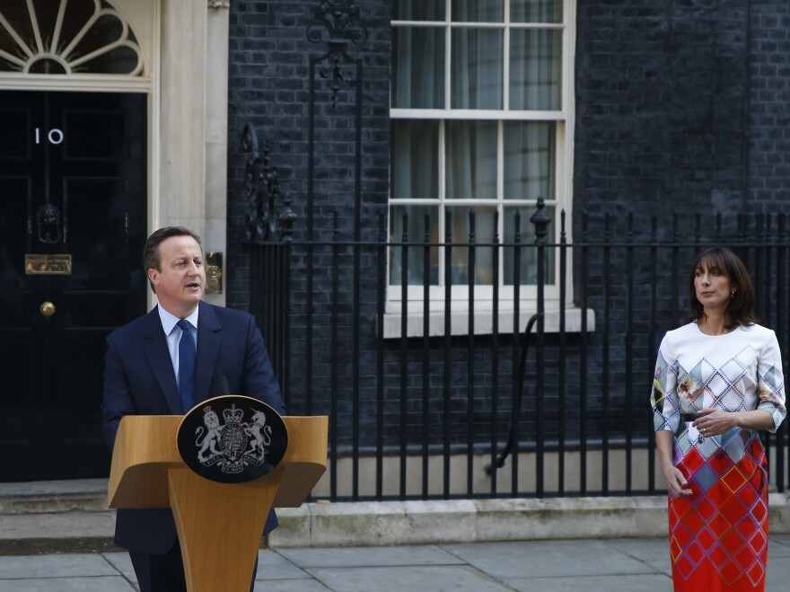 Britain's Prime Minister David Cameron, accompanied by his wife, Samantha, speaks to the media in front of 10 Downing St. on Friday as he announces his resignation following Britain's vote to leave the EU.