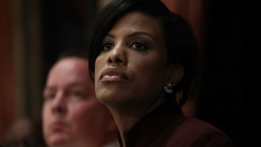 Baltimore Mayor Stephanie Rawlings-Blake  and Baltimore Police Department Commissioner Kevin Davis listen to a question during a press conference at City Hall on Wednesday.