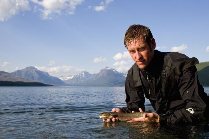 Clint Muhlfeld, an aquatic ecologist with the USGS, holds a native Westslope cutthroat trout in Glacier National Park.