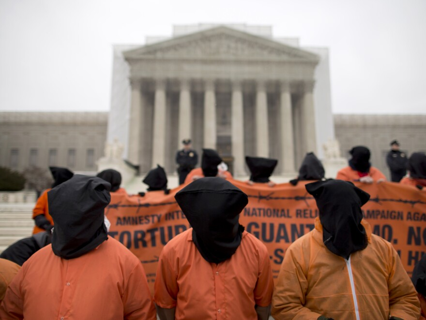 Demonstrators dressed as Guantanamo Bay detainees protest against the facility, in front of the U.S. Supreme Court in January.