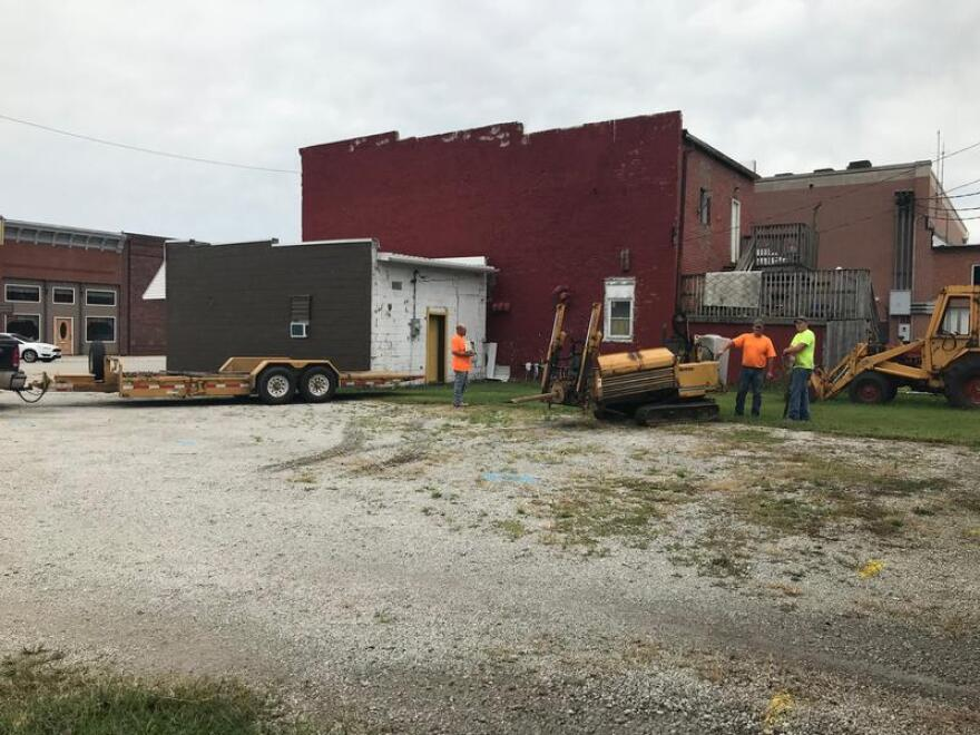 A construction crew digs into the ground to lay fiber optic cables in Lovington, Illinois. Shawnee Communications provides high-speed internet to the town of about 1,100 people.