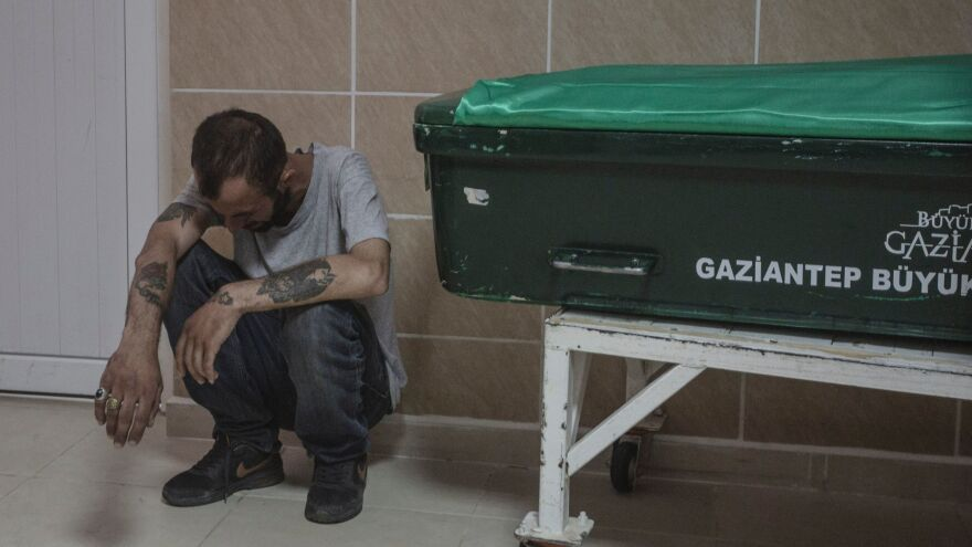 On Sunday, a man reacts next to the coffin of a victim from Saturday's attack on a wedding party that left more than 50 dead in Gaziantep in southeastern Turkey, near the Syrian border.
