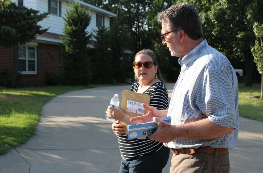 Just-retired teacher Linda Zehr out knocking on doors with Wichita school board member and candidate for the state Senate District 25, Lynn Rogers.