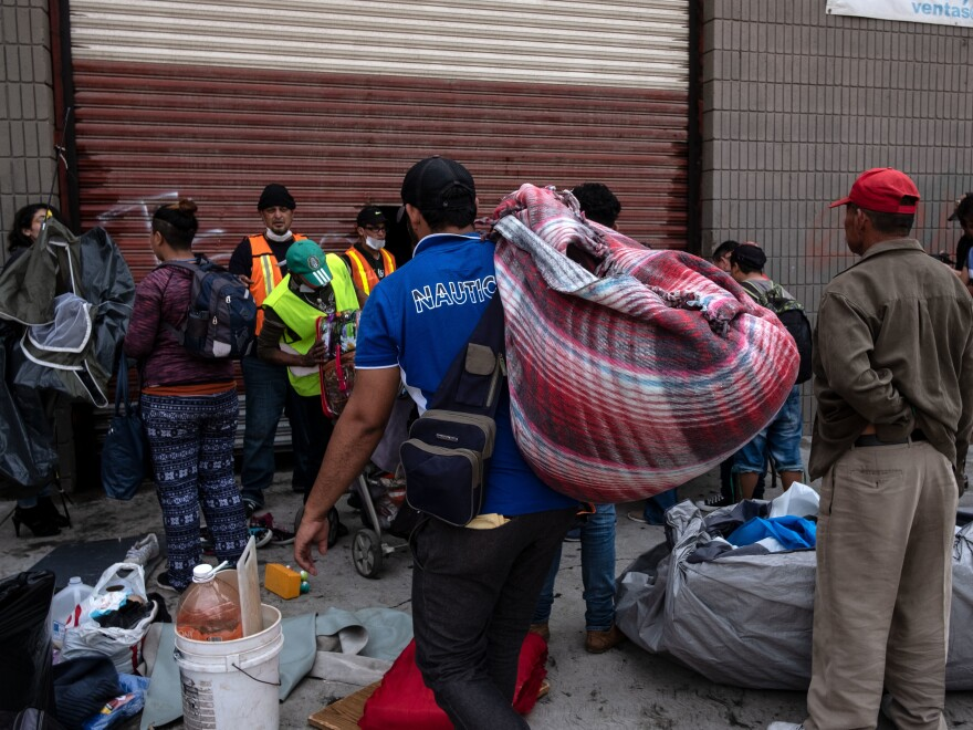 Central American migrants, hoping to ask for asylum in the United States, are being relocated to a temporary shelter in Tijuana, Mexico. Volunteers from San Diego visit the migrants weekly to help with health care.