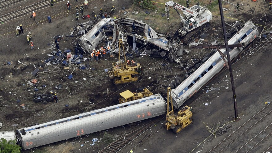 Emergency personnel work at the scene of a deadly train derailment in Philadelphia, which happened on May 12, 2015.