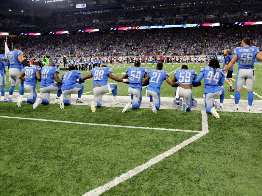Members of the Detroit Lions take a knee during the playing of the national anthem prior to the start of the game at Ford Field on September 24, 2017 in Detroit, Michigan.